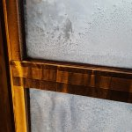 Build up of frost & condensation on thin room windows. Very drafty & cold in room!