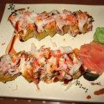 Volcano roll $8.99 Avocado tuna salmon white fish cream cheese deep fried w baked conch spicy cr
