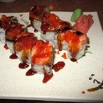 Double Dragon roll $8.99 Lobster salad, eel, mango, avocado inside, tobiko on top