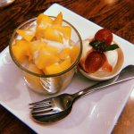 Sweet sticky rice with mango and vanilla ice cream.