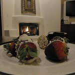 Chocolate covered strawberries and firelight