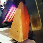 Raclette cheese on the grill, melting beautifully