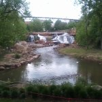 The view of Reedy River falls and the walking bridge from below