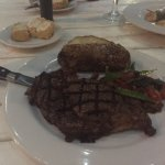 Ribeye steak with salted baked potatoes and sautéed vegetables