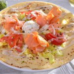 Norway - Smoked salmon served with lettuce, tomatoes, onions, capers & cream cheese