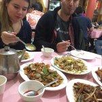 Having fun mealtime with a staff member (Nabil) and a fellow traveler in Chinatown