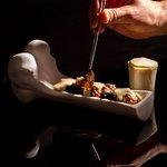 Tuétano de ternera, setas de temporada y espuma de patata trufada