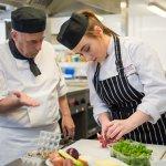 Preparing food at Scholars Restaurant, Widnes