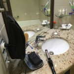 The only place with an outlet and mirror to do hair. Dangerous!