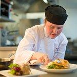 Preparing food at Scholars Restaurant
