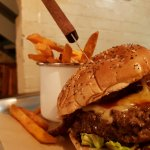 The Patriot burger and sweet potato fries served on a metal tray and baking paper