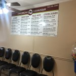 Menu board and chairs for takeout customers