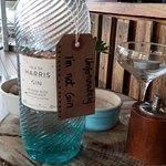 Bottle of water, pepper grinder & salt bowl