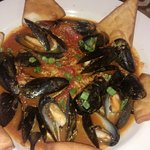 Spanish Style Fresh Mussels- Sauteed in a spicy tomato broth then served atop Spanish style Rice