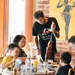 Kid-friendly and family atmosphere. Have fun and appreciate our food!