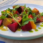 Roasted beets strawberries, citrus, almond, pistachio, mint