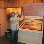 Museum Director Rae Whitley at the 1st New York Light Artillery flag - from Gettysburg. GREAT!