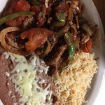 Lunch beef fajita w/beans and rice. I believe it was only around $6!