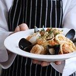 Enzo's trademark spaghetti al sapore di mare with fresh local seafood
