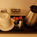 A kettle with tea and coffee.