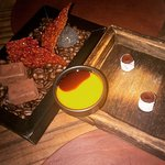 set of sweets - made of tomato, red seaweed, chocolate and marzipan; with sea buckthorn sauce