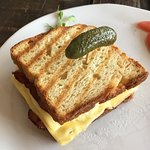 Gluten free bacon and cheese sandwich with tomatoes at 100% gluten free restaurant Bake Free