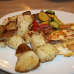 Tilapia, homestyle potatoes and summer vegetables