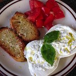 Burrata - Fresh Italian buffalo milk cheese made from mozzarella and cream.