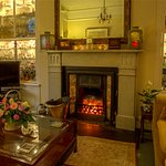 Our guest lounge with it's original fireplace from 1890.  Sit and relax in our guest lounge.