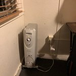Heater and one electrical outlet in room