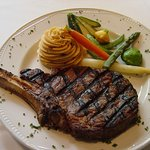16 oz. Angus bone in ribeye with chipotle mashed potatoes and baby vegetables
