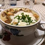 Garlic cream soup with croutons and root vegetables