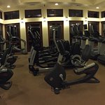 Cardio area of larger 24 hour gym near pool