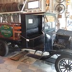 Old car and machine shop in the garage of the general store at the Pinellas County Heritage Vill