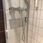 Shower head is far too low, but nice, clean and big shower