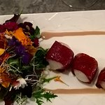 Scallps wrapped in cured ham with fresh flower salad
