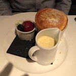 Apple crumble soufflé, crème anglaise and blackberry sorbet
