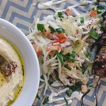 Daily made fresh Hummus with salad and skewer