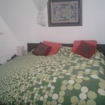 Bed vwith vibrant cover