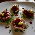 Seared tuna with tatsoi salad, Asian sun-dried tomato dressing and guacamole