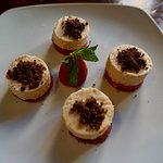 Peanut butter parfait with chocolate crumbs and strawberry jelly