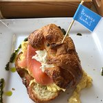 Scrambled eggs and smoked salmon filled croissant