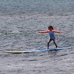 7 year old surfing like a pro