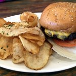 Family Guy Burger (American cheese, lettuce, tomato) w/ house made chips