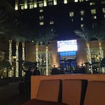 Outside bar area looking at the giant TV screen after sun down.