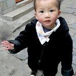 Tianlong Ancient Castle, local boy saying hello