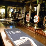 A pint of the finest beers await at the beautiful bar.