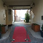 Front side entrance to hotel with red carpet