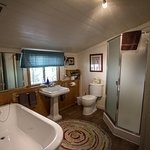 The Cottage bathroom, complete with tub and shower