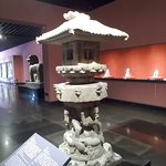 Display of a stone lantern inside the museum-like building (like a small museum)